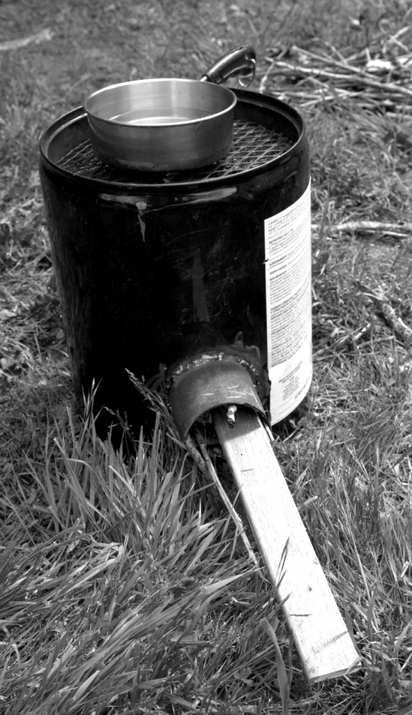 Rocket stove made from five gallon can, notice where you feed the wood in.