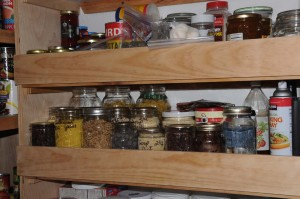 A simple piece of one by four secured to the front of your shelves will help keep your jars in place during a earthquake.